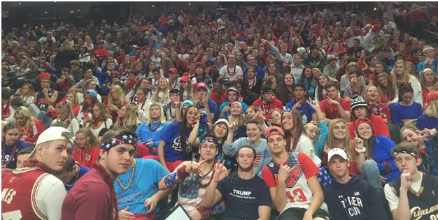 The Cougar student section dressed in red, white, and blue for Veterans Day. Plenty of students cheered loudly, sharing their school pride. Photo courtesy of the Cougar Activities twitter page.