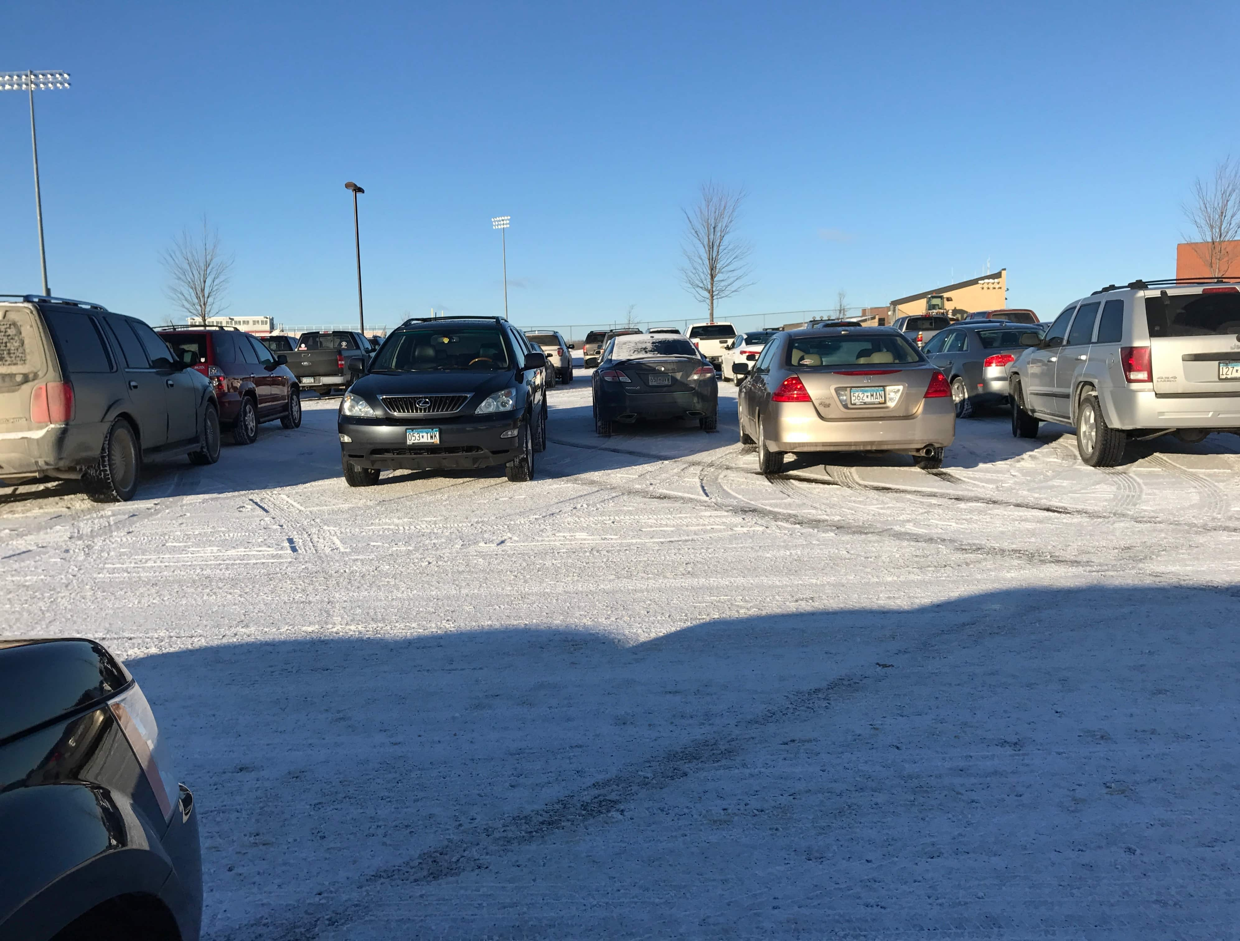 Cars parked in the LSHS parking lot. Photo by Katie Loveless