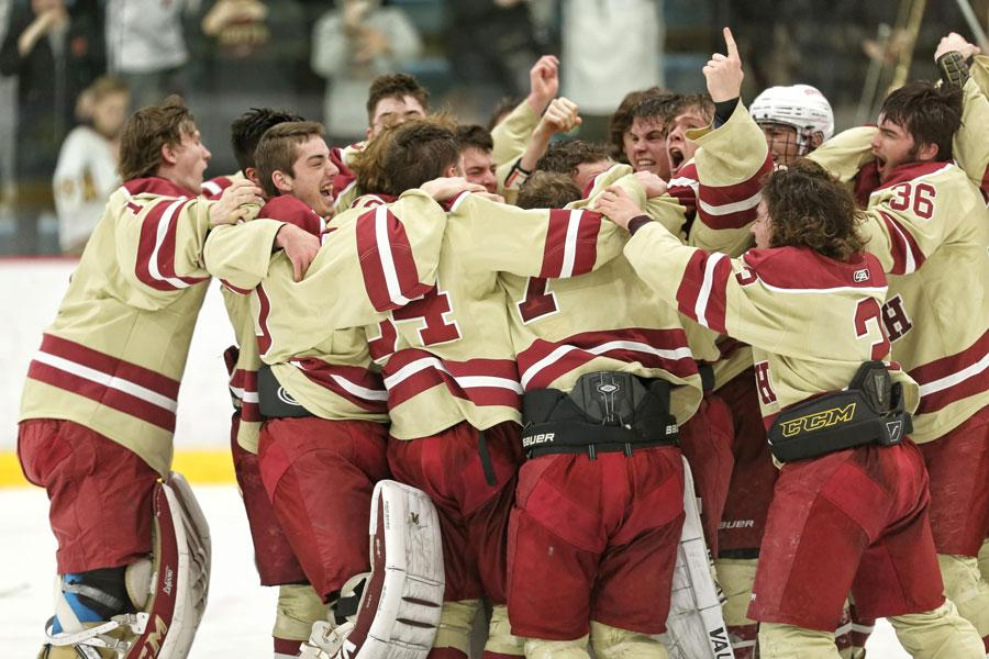 Players celebrate following a 3-1 win over Lakeville North